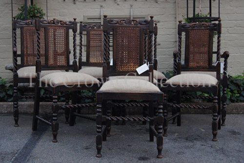 Set of 8 Carved Oak Dining Chairs with Rattan Back including 2 Carvers