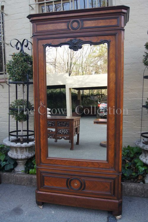 Mid 19th century Northern European Walnut and Ebonised single door Armoire