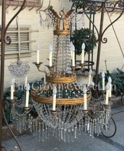 Crystal and Gilt-Metal Twelve Light Chandelier in the Louis XV style which originally hung in the Vatican. The chandelier was purchased by the antique dealer