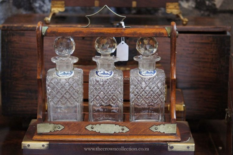 Antique Oak 3 Bottle Tantalus With Key & Delf Labels (One Bottle Cracked)