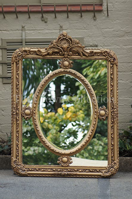 Dark gold ornate gilded mirror