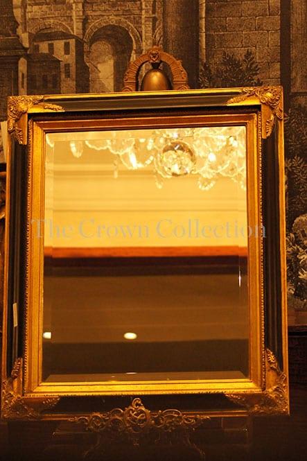 Gilt & black framed bevelled mirror