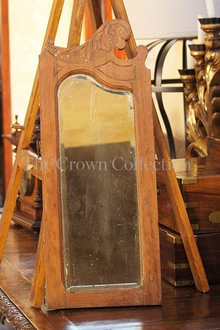 Carved wooden & bevelled mirror