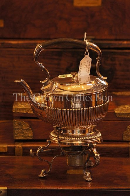Silver plated tea pot on burner
