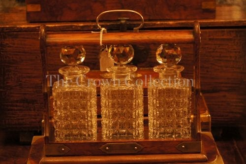 Tantalus with key & 3 decanters