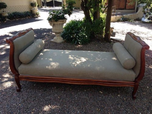 Victorian Style scroll carved daybed in Mahogany with new upholstery