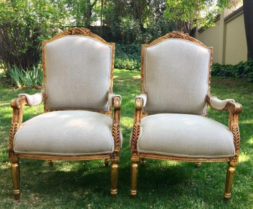A Pair of French Louis XVI Styled Ornately carved and gilded Fautelli  Chairs in Linen Upholstery