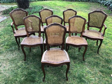 Set Of Eight French Style Walnut Dining Chairs With Rattan Backs