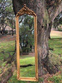 Ornately Carved and Gilded Bevelled Mirror