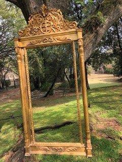 Ornately Carved and Gilded Bevelled Mirror