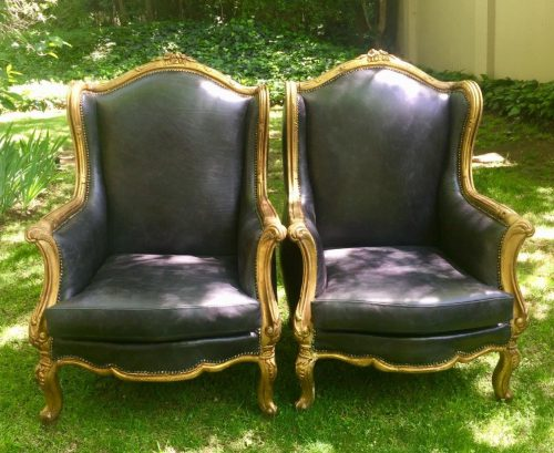A Pair of gilded Wingback chairs in Leather Upholstery