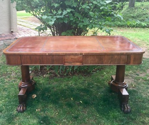 A Victorian Rosewood Library Table with tooled leather inset above two short drawers