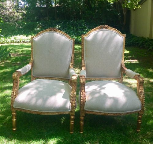 A Pair of French Ornately carved and gilded Fautelli Chairs with new Upholstery