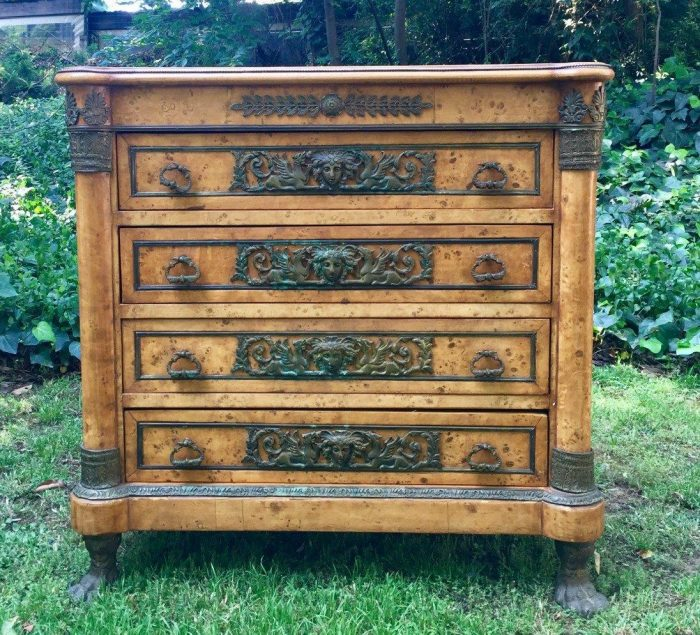 Early 20th Century French Empire style Chest of Drawers in Birds Eye Maple on Brass paw feet and handles