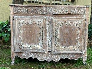 A French Provincial styled Ornately carved 2 door sideboard