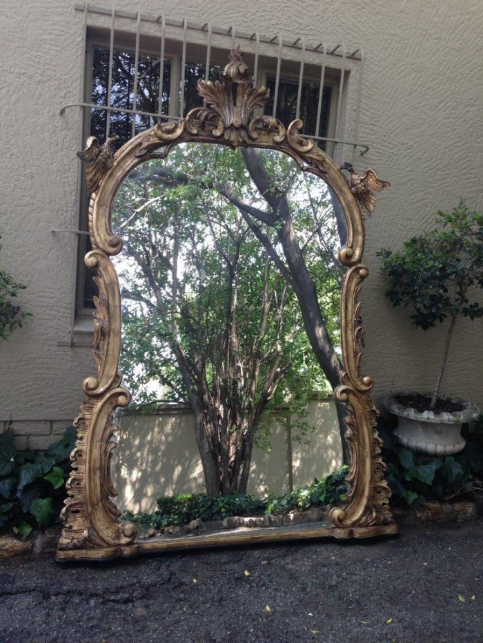 gilded and ornate mirror