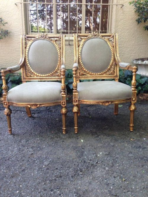 Pair of French style gilded armchairs