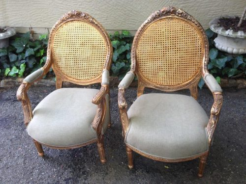 Pair of French style gilded rattan back armchairs