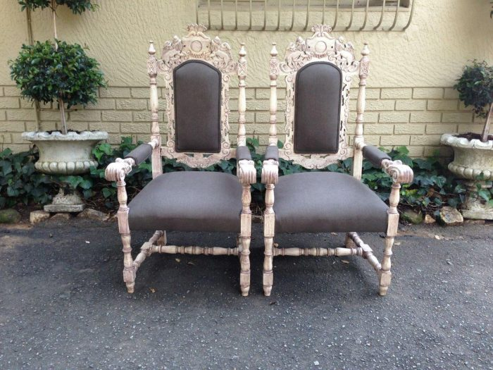 Pair of 19thC carved teak open arm throne chairs