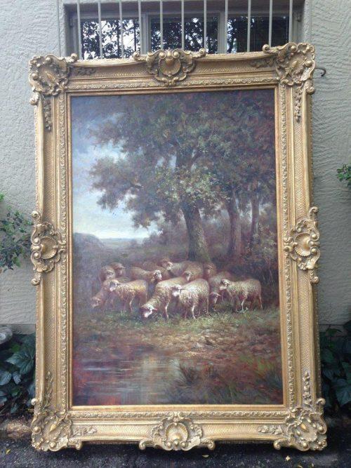 Oversized oil painting of sheep scene in ornate gilded frame