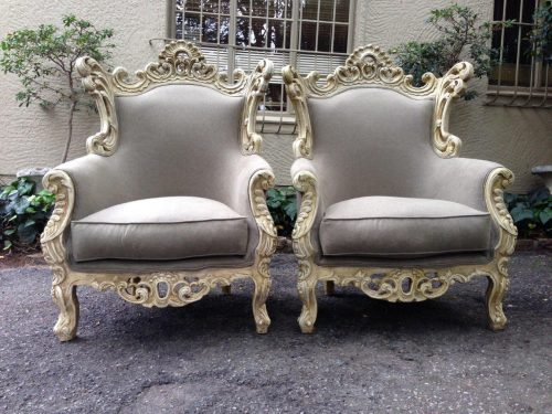 Pair of ornately carved oversized Baroque style chairs