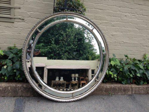 Large ornate round mirror