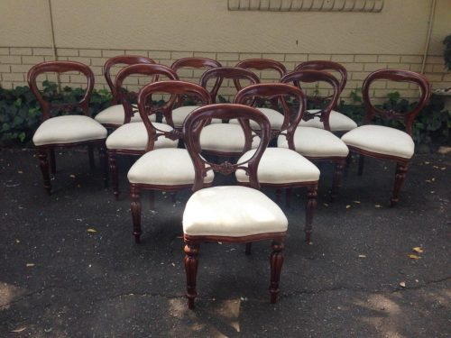 Set of 12 bustle back mahogany chairs. Circa Late 1900's English/Edwardian *Brand New Upholstery*