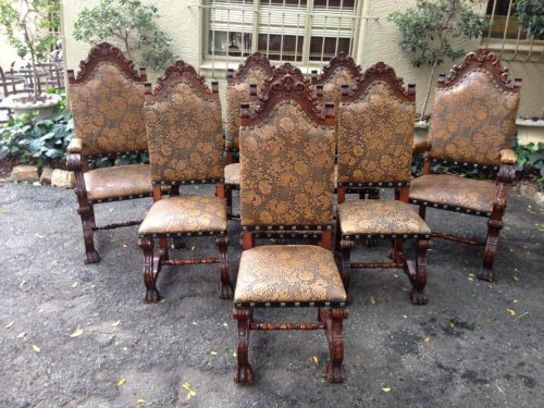 A Set of 8 (2 carvers and 6 dining chairs) leather embossed dining chairs