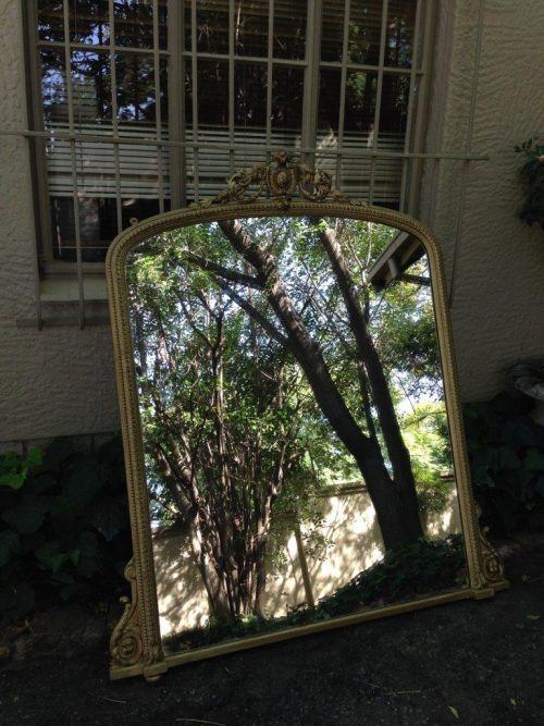 A French gilded wall mirror in the Rococo style. Late 19th Century.