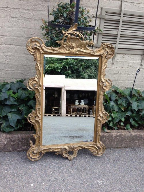 A Gilt Rococo-Style Frame With Bevelled Mirror Plate