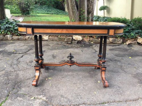 A 19th C Empire style quarter veneered burr maple stretcher table
