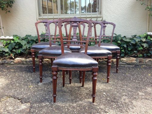 Set of six late Victorian mahogany dining chairs with carved backs on turned legs