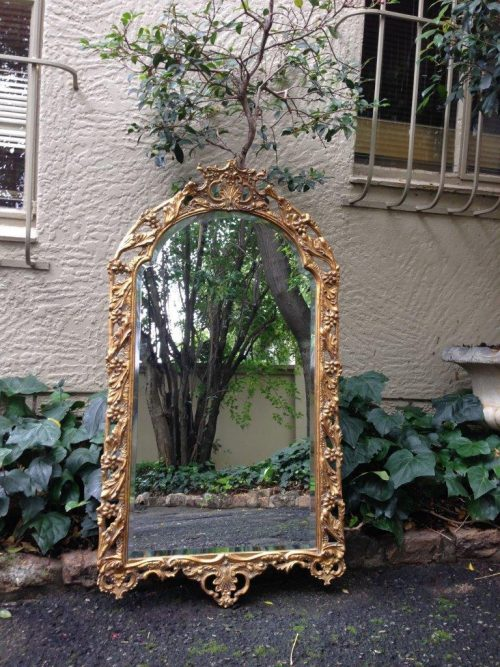 Large arched mirror with gilt frame