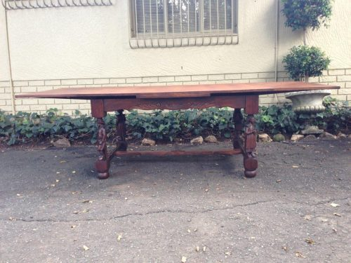 French oak table with parquetry top and figural legs and cross stretcher