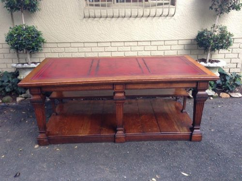 Oak library table with tooled-leather top