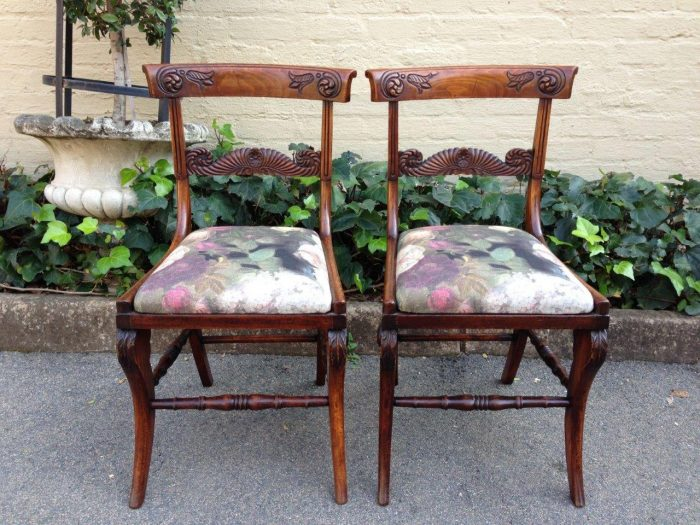 A Pair of Regency carved Dining chairs in Mahogany in imported upholstery