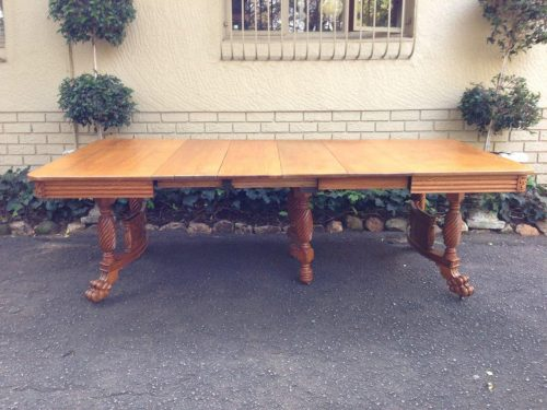 American Colonial oak extending dining table with lion paw feet