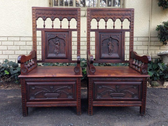 A pair of Carved Walnut Baronial Throne Chairs