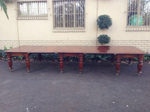 A Regency Exceptional Dining table in Mahogany on fluted legs and brass castors (20 – 22 Seater) from Durban Officers Mess. C1820