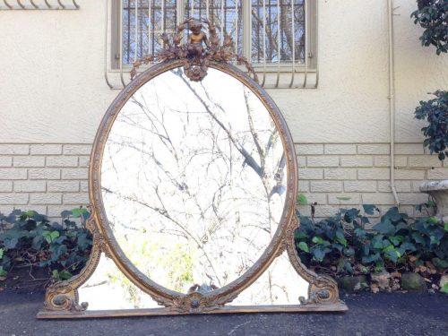 An Antique Oval Gilt Mirror