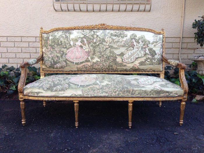 A gilt-painted sofa with French tapestry upholstery