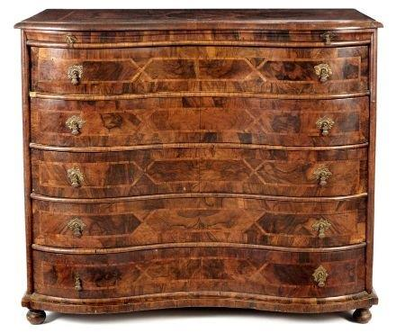 A Continental Walnut And Crossbanded Chest Of Drawers
