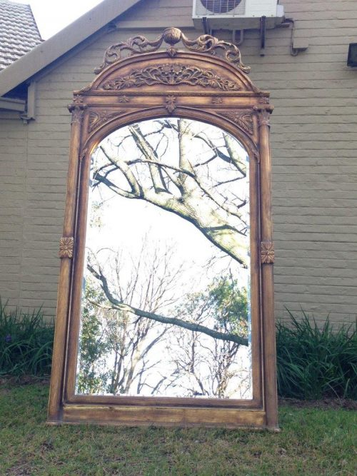 An Ornate Carved & Bevelled Mirror