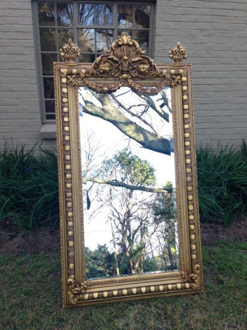 An Ornate Carved Painted Mirror