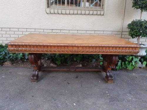 A Victorian Style Ornately Carved Oak Dining Table