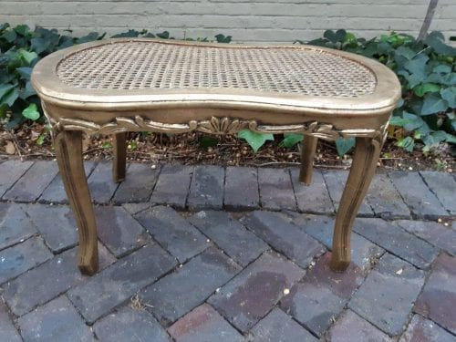 A Pair of Gilded and Oval Rattan Tables