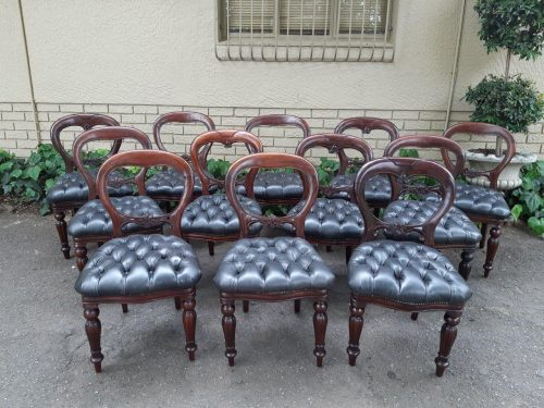 A Set Of 6 Early 20th Century Mahogany Bustle Back Chairs With Deep Buttoned Leather Upholstery