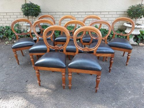 A Set Of 10 Mahogany Balloon-Back Dining Chairs Newly Upholstered In Black Leather And Deep Buttoned