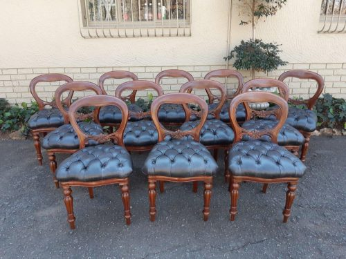 A Set of Twelve (12) Victorian Style Mahogany Bustle Back Dining Chairs (New Imported Upholstery)