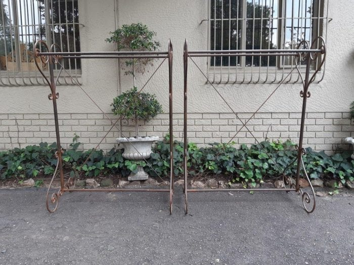 Pair of double sided wrought iron gilded rails